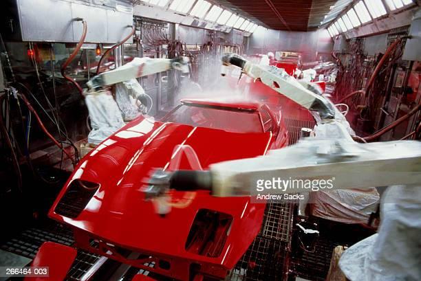 Automobile production line, robotic arms spraying car bodies