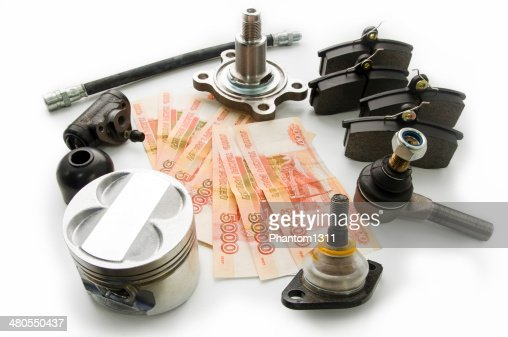 Automobile spare parts and money : Stock Photo