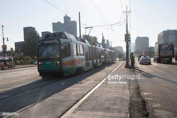 Automobile traffic and an MBTA Green Line train move along the Commonwealth Avenue Bridge in Boston as it reopens to traffic on Aug 16 2017 The...