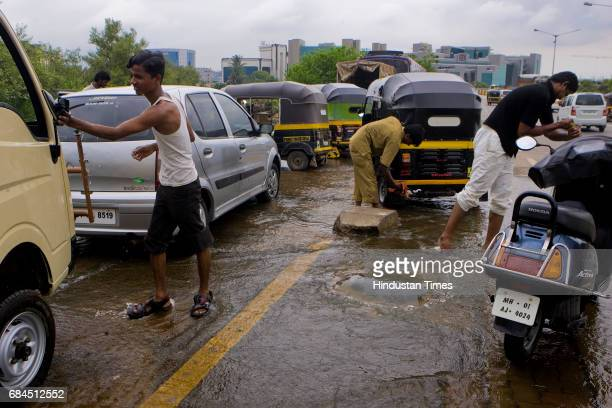 Automobile Washing Motorists take advantage of a pipeline burst at BKC and was their vehicles in the water spilling on the roads Motorists claim that...