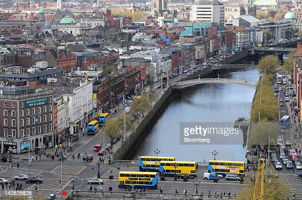 Automobiles and buses are seen near commercial and residential properties on the River Liffey in Dublin Ireland on Thursday April 12 2012 The Irish...