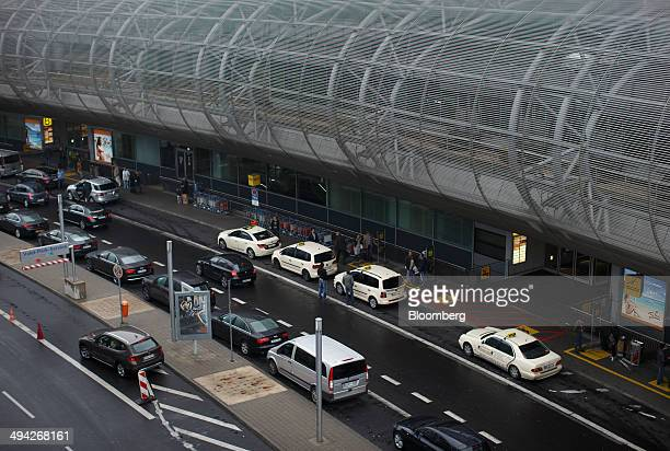 Automobiles and taxis stand outside Dusseldorf airport operated by Flughafen Dusseldorf GmbH in Dusseldorf Germany on Wednesday May 28 2014 Emirates...
