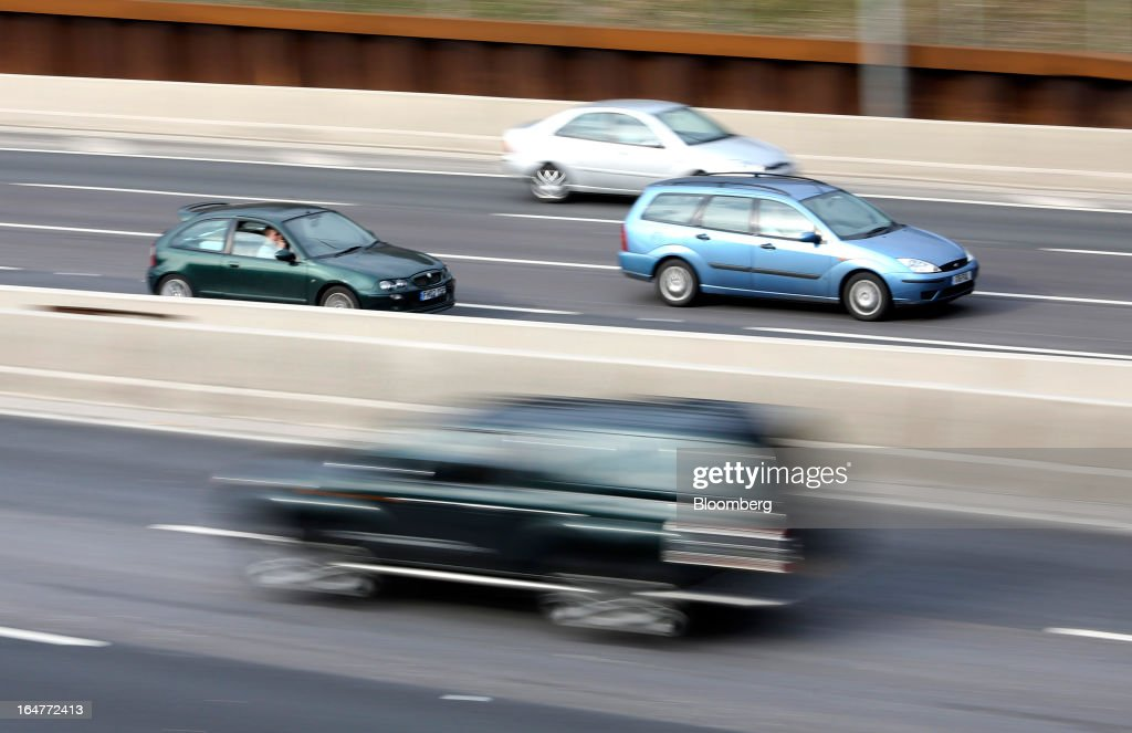 Automobiles are seen travelling along the northern section of the M25 motorway near London, U.K., on Wednesday, March 27, 2013. The U.K. government will increase spending on infrastructure projects, including road construction, by an annual 3 billion pounds ($4.6 billion) from 2015 as Chancellor George Osborne seeks to boost economic growth. Photographer: Chris Ratcliffe/Bloomberg via Getty Images