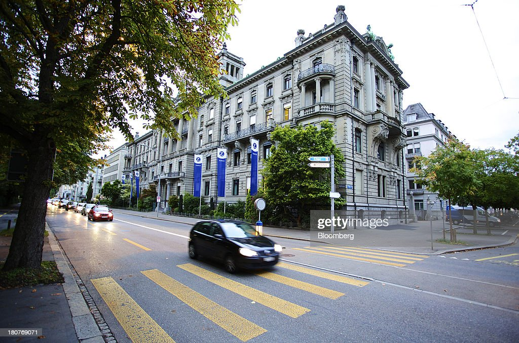 Automobiles drive past Zurich Insurance Group AG's headquarters in Zurich, Switzerland, on Monday, Sept. 16, 2013. Zurich Insurance named Tom de Swaan chairman, replacing Josef Ackermann, who stepped down after the suicide of Chief Financial Officer Pierre Wauthier. Photographer: Gianluca Colla/Bloomberg via Getty Images