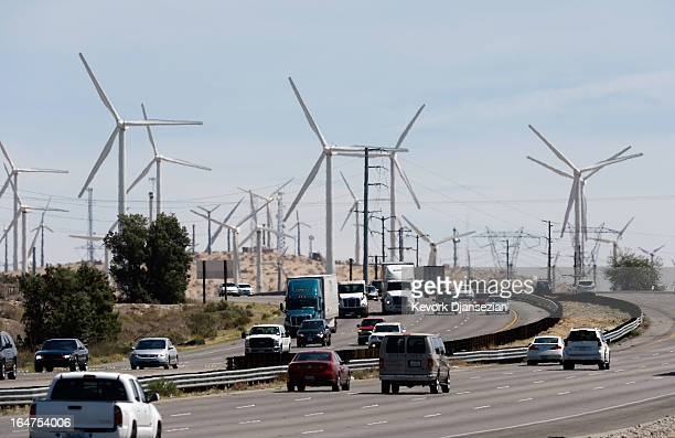 Automobiles pass by giant wind turbines powered by strong winds on March 27 2013 in Palm Springs California According to reports California continues...