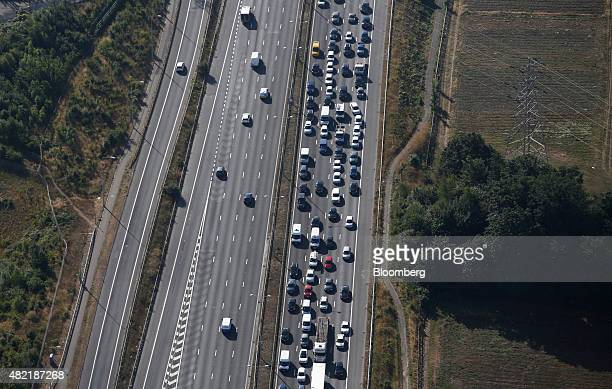 Automobiles sit in a traffic jam on the M2 motorway near Dartford UK on Wednesday July 22 2015 Passenger journeys on the UK rail network rose more...