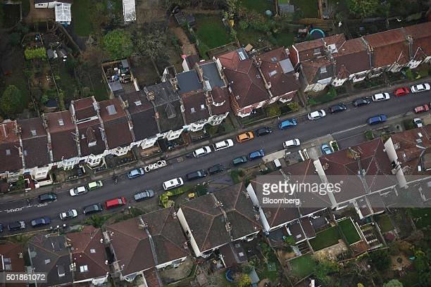 Automobiles stand parked in the street outside residential houses in this aerial photograph taken over Bristol UK on Thursday Dec 17 2015 UK asking...