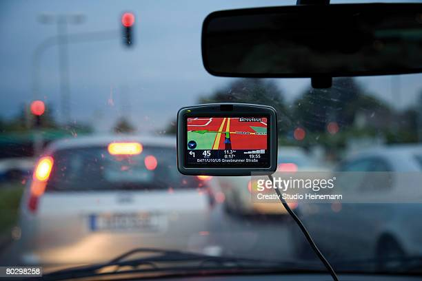 Automotive navigation system on car dashboard, close-up