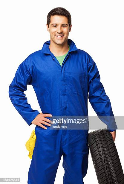 Automotive Technician Holding a Spare Tire - Isolated