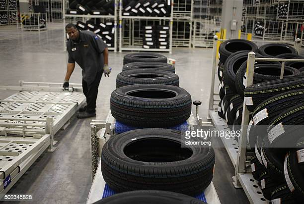 Automotive tires move down a conveyor belt before being loaded onto a truck for shipment at the Continental Tire Sumter plant distribution warehouse...