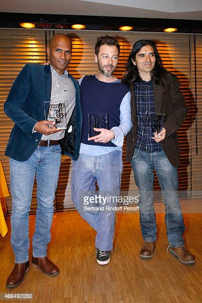 Autor Michael SeilhanIbrahim Autor Composer and Singer Christophe Mae and Composer Felipe Saldivia pose with their 'Song Award' for the song 'Tombe...