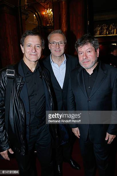 Autor of the piece Laurent Ruquier standing between actors of the piece Francis Huster and Regis Laspales pose after the 'A Droite A Gauche' Theater...