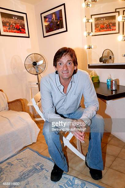 Autor of the play and actor Pierre Palmade poses backstage after 'Le fils du comique' play at the 30th Ramatuelle Festival Day 7 on August 7 2014 in...