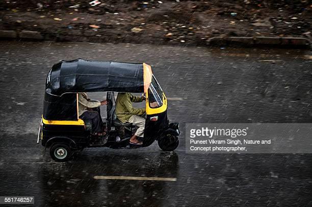 Autorickshaw drive in rain