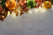 frame of autumnal fruits and vegetables with garland of lights