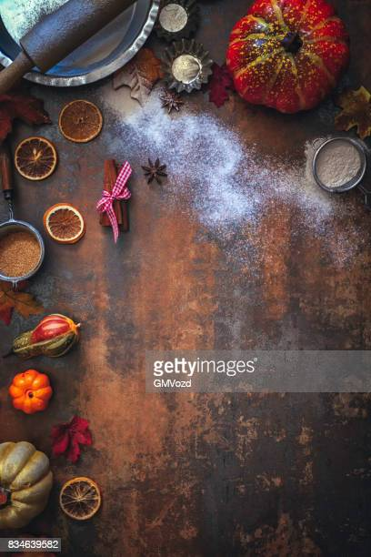 Autumn Background with Nuts, Spices and Candied Oranges