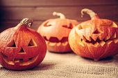 autumn background with orange halloween pumpkins on rustic background