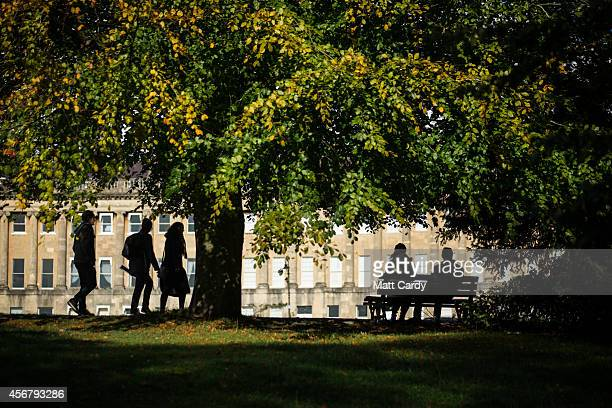 Autumn colours begin to show on trees in front of the Royal Crescent in the Royal Victoria Park on October 7 2014 in Bath England Despite the current...