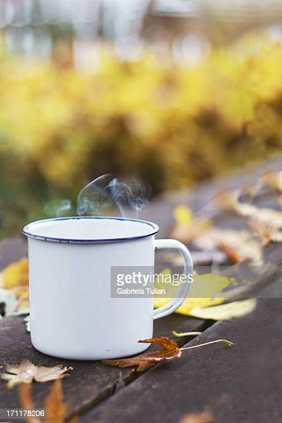 Autumn cup of coffee with smoke