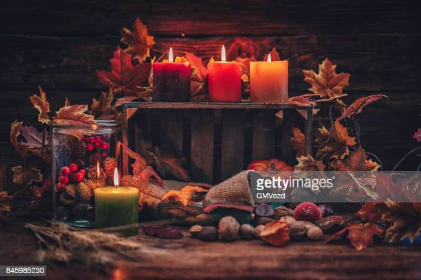 Autumn Decoration Background with Candles, Pumpkins, Leafs and Nuts