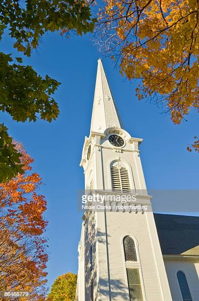 Autumn fall colours around traditional white timber clad church, Manchester, Vermont, New England, United States of America, North America