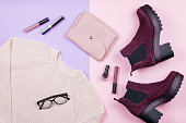 Autumn female clothing and accessories on pastel background. Top view