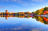 Autumn foliage along Jamaica Pond in Boston's Jamaica Plain neighborhood. Boston is the largest city in New England, the capital of the state of Massachusetts. Boston is known for its central role in