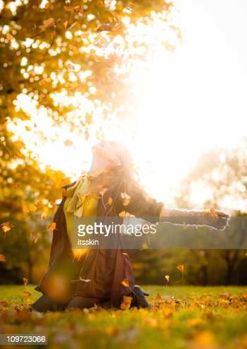 Autumn fun with leaves : Stock Photo
