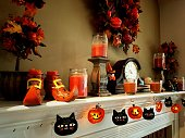 Fall decorations mounted above a home fireplace