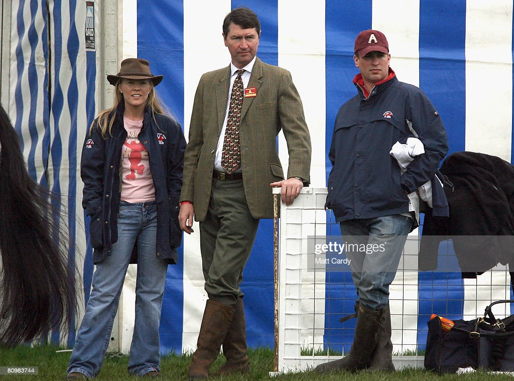 Autumn Kelly, Tim Laurence and Peter Phillips watch the horses warm up before the show jumping during the Badminton Horse Trials on May 4 2008 in Badminton, England. Reigning world champion Zara Phillips rode Glenbuck and Ardfield Magic Star at the event - as the British equestrian team look to finalise their 2008 Olympics squad. The event started with two days of dressage then went into cross country before finishing with the jumping test on today.