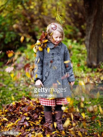 Autumn leaves falling on girl : Stock Photo
