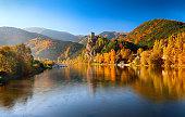Autumn morning view of Vag River, near Zilina, Slovakia