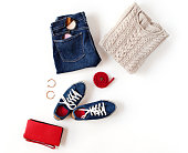 Autumn outfit. Women's fashion clothes and accessories in blue and red colors isolated on white background. Flat lay, top view.