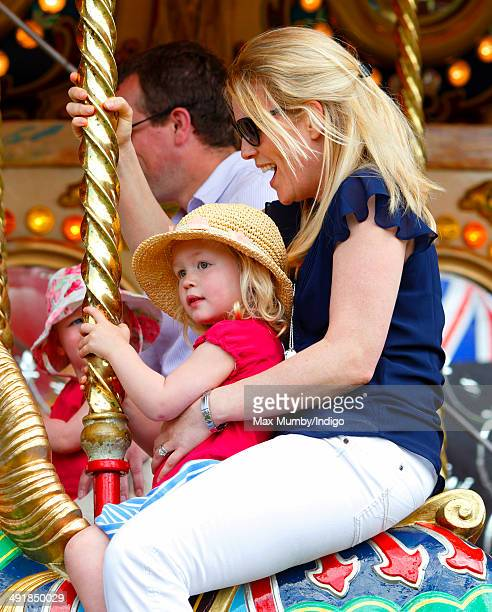 Autumn Phillips And Daughter Savannah Ride A Merry Go Round During Day 4 Of The