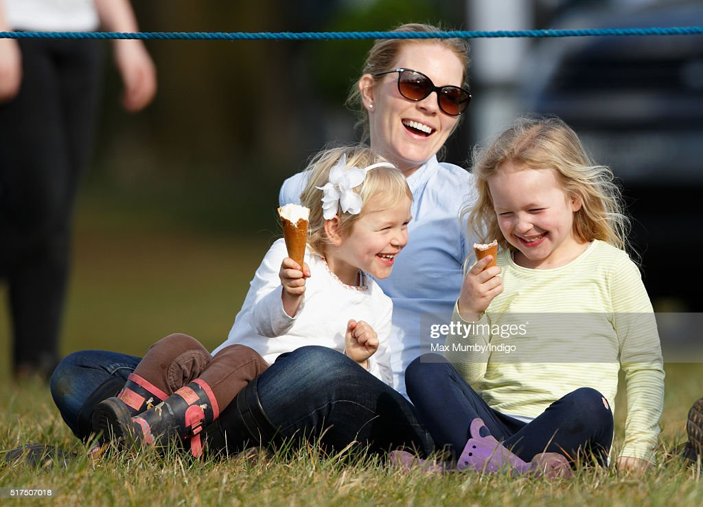 Autumn Phillips and daughters Isla Phillips (l) and Savannah Phillips (r) eat ice creams as they watch the show jumping during the Gatcombe Horse Trails at Gatcombe Park, Minchinhampton on March 25, 2016 in Stroud, England.
