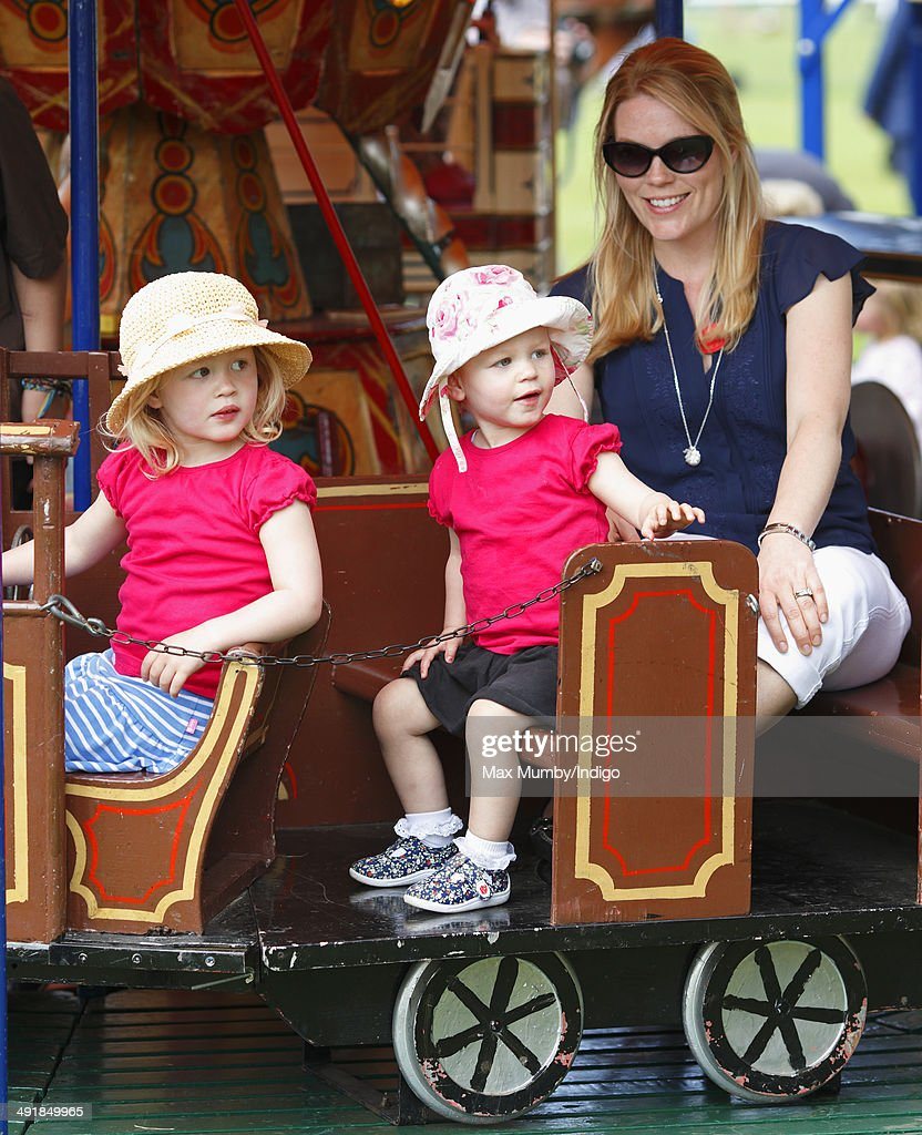 Autumn Phillips and daughters Savannah Phillips (left) and Isla Phillips (centre) ride a merry go round during day 4 of the Royal Windsor Horse Show at Home Park on May 17, 2014 in Windsor, England.