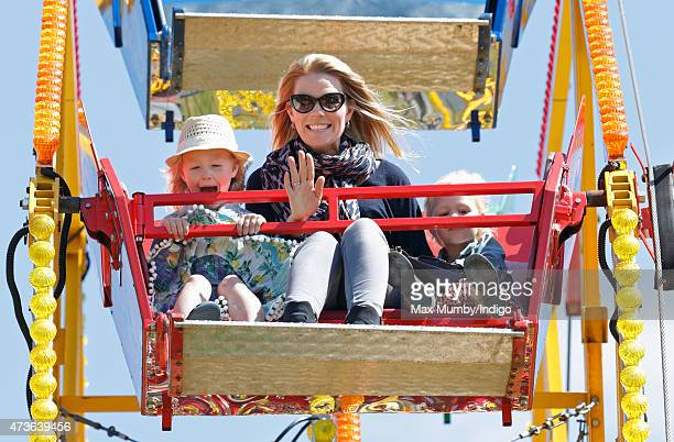 Autumn Phillips and daughters Savannah Phillips and Isla Phillips ride on a Ferris wheel as they attend day 4 of the Royal Windsor Horse Show in Home...