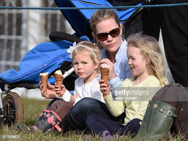 Autumn Phillips and her daughters Savannah and Isla enjoy ice creams at the Land Rover Horse Trials at Gatcombe Park on March 25 2016 in Stroud...