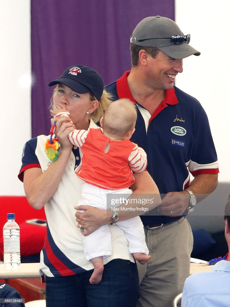 <a gi-track='captionPersonalityLinkClicked' href=/galleries/search?phrase=Autumn+Phillips&family=editorial&specificpeople=728048 ng-click='$event.stopPropagation()'>Autumn Phillips</a> and <a gi-track='captionPersonalityLinkClicked' href=/galleries/search?phrase=Peter+Phillips&family=editorial&specificpeople=160043 ng-click='$event.stopPropagation()'>Peter Phillips</a> play with <a gi-track='captionPersonalityLinkClicked' href=/galleries/search?phrase=Mia+Tindall&family=editorial&specificpeople=12480820 ng-click='$event.stopPropagation()'>Mia Tindall</a> (daughter of Zara Phillips and Mike Tindall) as they attend day 3 of the Festival of British Eventing at Gatcombe Park on August 3, 2014 in Minchinhampton, England.