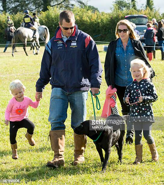 Autumn Phillips and Peter Phillips with Savannah Phillips and Isla Phillips attend the Whatley Manor International Horse Trials at Gatcombe Park on...