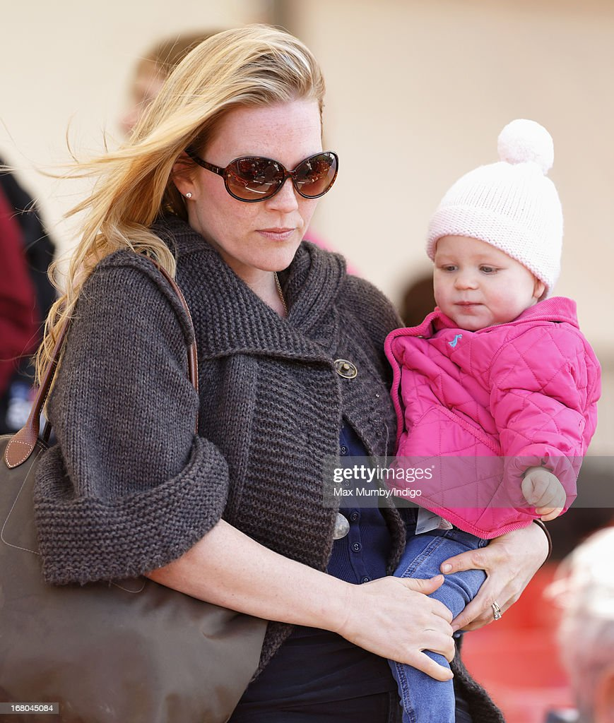 <a gi-track='captionPersonalityLinkClicked' href=/galleries/search?phrase=Autumn+Phillips&family=editorial&specificpeople=728048 ng-click='$event.stopPropagation()'>Autumn Phillips</a> carries daughter Isla Phillips as they attend day 3 of the Badminton Horse Trials on May 4, 2013 in Badminton, England.