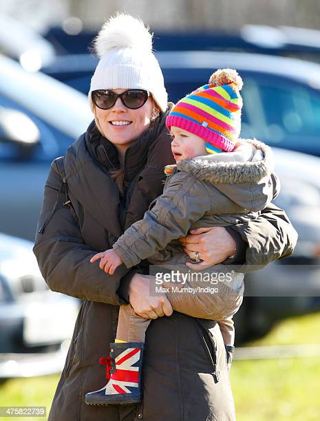 Autumn Phillips carries daughter Isla Phillips as they attend The Duke of Beaufort's Hunt PointtoPoint Race meet in Didmarton on March 1 2014 near...