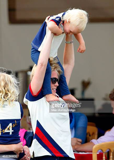 Autumn Phillips carries daughter Isla Phillips on her shoulders as she attends day 2 of the Festival of British Eventing at Gatcombe Park on August 2...
