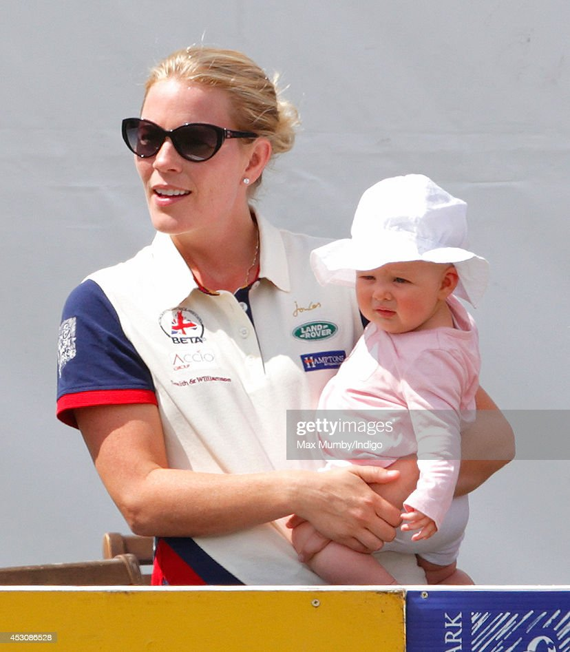 <a gi-track='captionPersonalityLinkClicked' href=/galleries/search?phrase=Autumn+Phillips&family=editorial&specificpeople=728048 ng-click='$event.stopPropagation()'>Autumn Phillips</a> carries Zara Phillips' daughter <a gi-track='captionPersonalityLinkClicked' href=/galleries/search?phrase=Mia+Tindall&family=editorial&specificpeople=12480820 ng-click='$event.stopPropagation()'>Mia Tindall</a> as they attend day 2 of the Festival of British Eventing at Gatcombe Park on August 2, 2014 in Minchinhampton, England.