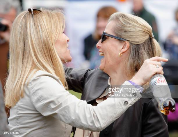 Autumn Phillips hugs Sophie Countess of Wessex as they attend day 4 of the Royal Windsor Horse Show in Home Park on May 13 2017 in Windsor England