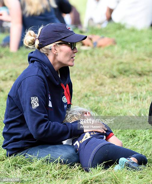 Autumn Phillips plays with daughter Savannah Phillips during the Festival of British Eventing at Gatcombe Park on August 03 2014 in Minchinhampton...