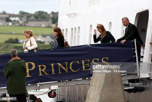 Autumn Phillips Princess Eugenie Princess Beatrice and the Duke of York as they disembark from the Hebridean Princess boat after a family holiday...