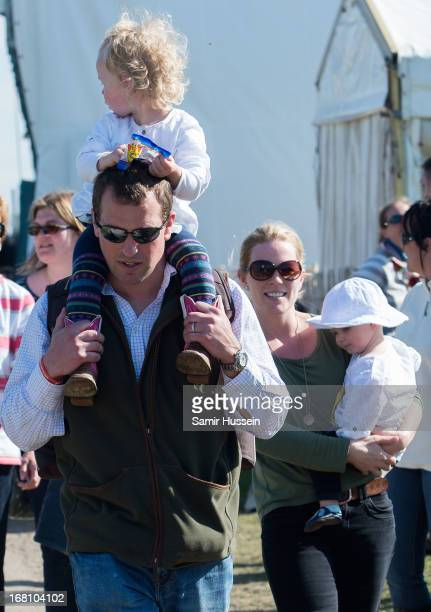 Autumn Phillps with Isla Phillips and Peter Phillips with Savannah Phillips attend Day 4 of the Badminton Horse Trials on May 5 2013 in Badminton...