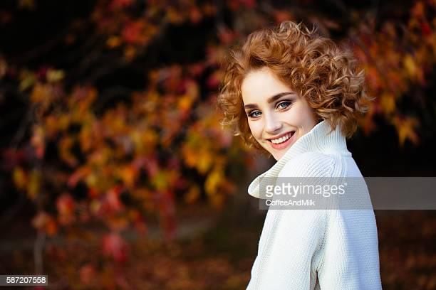 Autumn photo of a beautiful girl