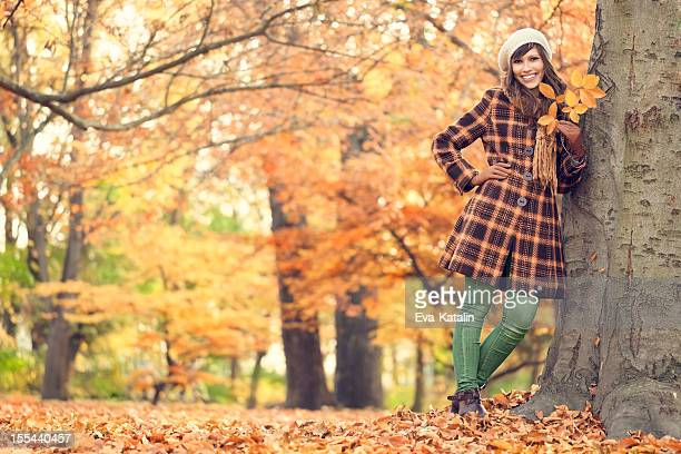 Autumn portrait of a cheerful woman
